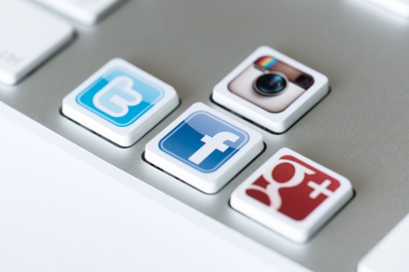 Kiev, Ukraine - May 20, 2013 - A social media icons of Facebook, Twitter, Google Plus and Instagram placed on computer keyboard keys. Editorial
