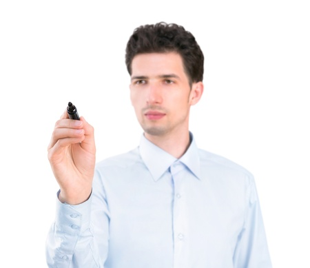 Portrait of a young pensive businessman holding a marker and writing on the empty copyspace  Isolated on white background  Stock Photo - 20110591