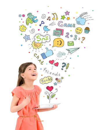 games hand: Happy cute little girl in red dress holding a digital tablet in hand and fascinated looking up at the colorful icons of different entertainment apps  Isolated on white background