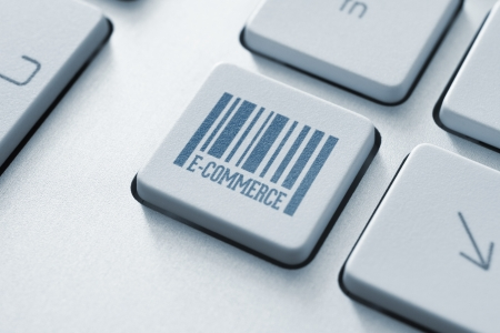 technology transaction: E-commerce button on a modern computer keyboard Stock Photo