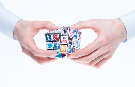 include: Kiev, Ukraine - February 2, 2013 - A hands holding rubiks cube with logotypes of well-known social media brands. Include Facebook, YouTube, Twitter, Google Plus, Instagram, Vimeo, Flickr, Myspace, Tumblr, Livejournal, Foursquare and other logos. Editorial
