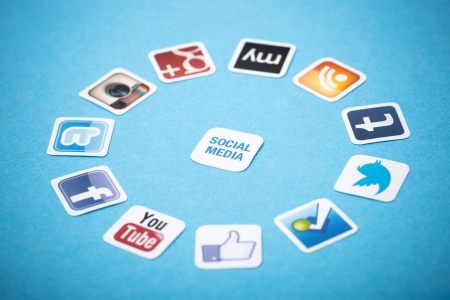 Kiev, Ukraine - June 11, 2013 - A logotype collection of well-known social media brands printed on paper and placed around on a blue background. Stock Photo - 20372122