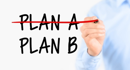 tasks: Business plan strategy changing  Businessman crossing over plan A, writing plan B  Isolated on white background