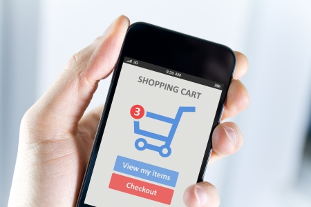 e cart: Mens hand holding modern mobile phone with online shopping application on a screen