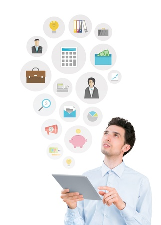 network marketing: Handsome young man holding digital tablet computer and looking on collection of mobile application icons on business and financial theme  Isolated on white background  Stock Photo
