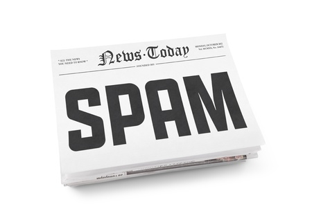 disinformation: Spam word writing on the front page of newspaper stack  Isolated on white background Stock Photo