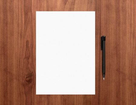 Blank white paper with pen on a wooden desk  High quality graphic collage  photo