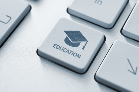 forums: Button with graduation cap icon on a modern computer keyboard  Online education concept