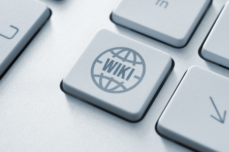 wiki: Computer button on a keyboard with wiki encyclopedia icon symbol Stock Photo