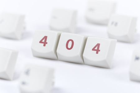 Concept of computer keyboard button with 404 web page error message sign on white background  photo