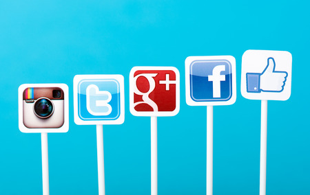 Media: KIEV, UKRAINE - MAY 25, 2014: A collection of well-known social media brands printed on paper and placed on plastic signs. Include Facebook, Twitter, Google Plus and Instagram logos.