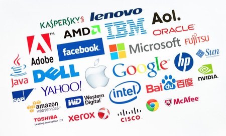 KIEV, UKRAINE - MAY 22, 2014: A logotype collection of well-known world top companies  of computer technologies on a monitor screen. Include Google, Apple, Microsoft, IBM, Adobe, Intel and other logo. Editorial