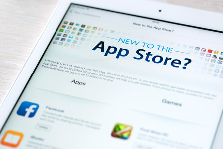 KIEV, UKRAINE - JUNE 05, 2014: App Store features information page on brand new Apple iPad Air. App Store is a digital distribution service for mobile apps on iOS platform, developed by Apple Inc. Apple iPad Air is developed by Apple inc. and was released Stock Photo - 28936412