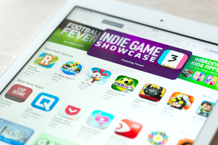 digital distribution: KIEV, UKRAINE - JUNE 05, 2014: Brand new modern white Apple iPad Air with featured mobile games apps in App Store collection. App Store is a digital distribution service for mobile apps on iOS platform, developed by Apple Inc. Apple iPad Air is developed  Editorial