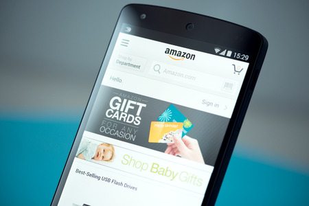 android: Kiev, Ukraine - September 22, 2014: Clouse-up shot of brand new Google Nexus 5, powered by Android 4.4 version, with Amazon website page on a screen.