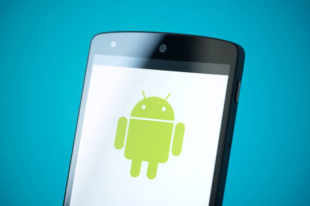android: Kiev, Ukraine - September 24, 2014: Close-up shot of brand new Google Nexus 5, powered by Android 4.4 version, with Android logotype on a screen. Editorial