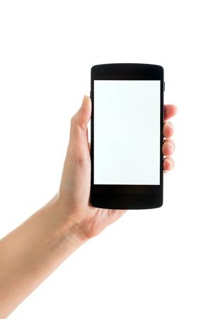 空白の画面を持つブランドの新しい Google ネクサス 5 を持つ女性の手のキエフ、2014 年 9 月 17 日: スタジオ ショット。Google ネクサス 5 LG 電子によっ 報道画像