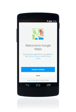 android: Kiev, Ukraine - September 12, 2014: Studio shot of brand new Google Nexus 5, powered by Android 4.4 version, with Google Maps application on a screen. Isolated on white background.