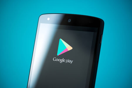 google play: Kiev, Ukraine - September 24, 2014: Close-up shot of brand new Google Nexus 5, powered by Android 4.4 version, with Google Play logotype on a screen.