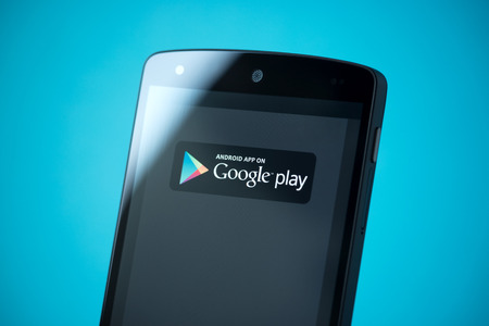 google play: Kiev, Ukraine - September 24, 2014: Close-up shot of brand new Google Nexus 5, powered by Android 4.4 version, with Google Play sign on a screen.