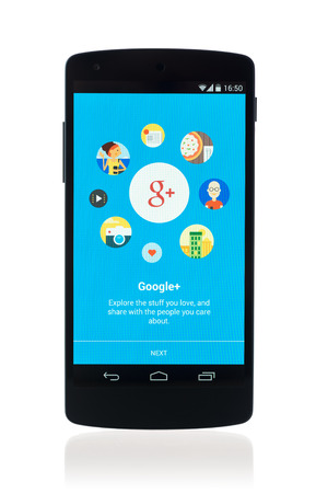 Kiev, Ukraine - September 12, 2014: Studio shot of brand new Google Nexus 5, powered by Android 4.4 version, with Google Plus mobile application on a screen. Isolated on white background.