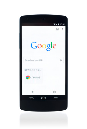 find: Kiev, Ukraine - September 12, 2014: Studio shot of brand new Google Nexus 5, powered by Android 4.4 version, with Google search webpage in Chrome browser on a screen. Isolated on white background.