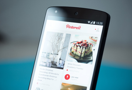 Kiev, Ukraine - September 22, 2014: Close-up shot of brand new Google Nexus 5, powered by Android 4.4 version, with Pinterest application boards on a screen.