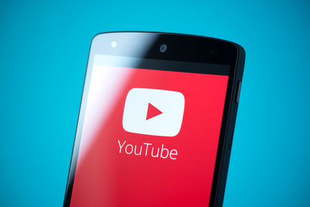 youtube: Kiev, Ukraine - September 24, 2014: Close-up shot of brand new Google Nexus 5, powered by Android 4.4 version, with YouTube logotype on a screen.  Editorial
