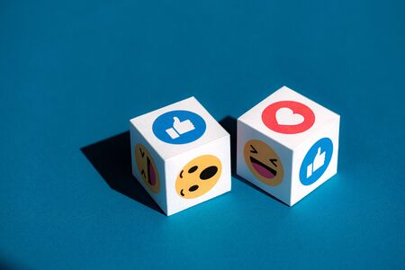 Kyiv, Ukraine - September 5, 2019: A paper cubes with printed emojis from Facebook Messenger, one of the biggest and world-famous social network.