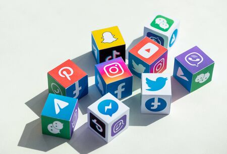 Kyiv, Ukraine - September 5, 2019: A paper cubes collection with printed logos of world-famous social networks and online messengers, such as Facebook, Instagram, YouTube, Telegram and others. Redakční