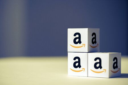 Kyiv, Ukraine - September 10, 2019: A shot of paper cubes with the printed logotype of the Amazon company. Amazon.com, Inc., is a well-known American multinational technology company. Redakční