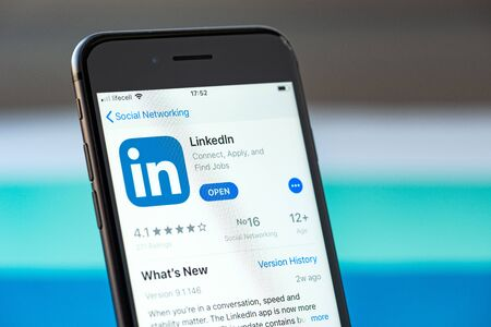 Kyiv, Ukraine - September 17, 2019: Studio shot of Apple iPhone 8 smartphone with a LinkedIn mobile application on the screen, from the download page on App Store platform.