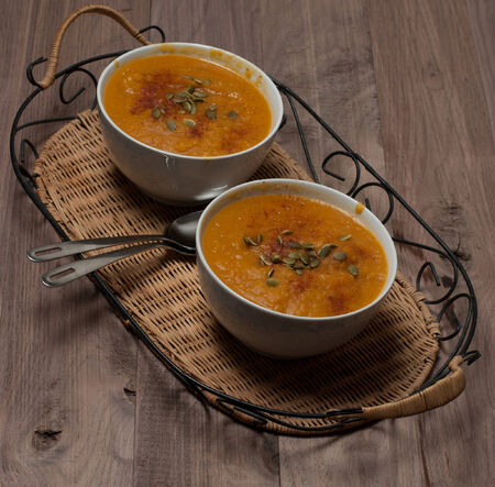 Pumkin Soup with Seeds and Paprika on Vintage Tray Stock Photo