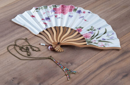 Japanese Hand Fan and Pendant in Shape of Eiffel Tower photo