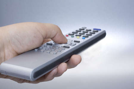 tv remote: Silver remote control in hand