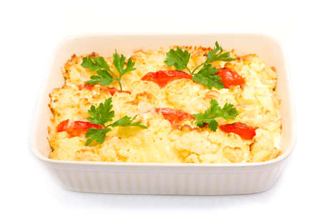 Baked cauliflower with tomato over white