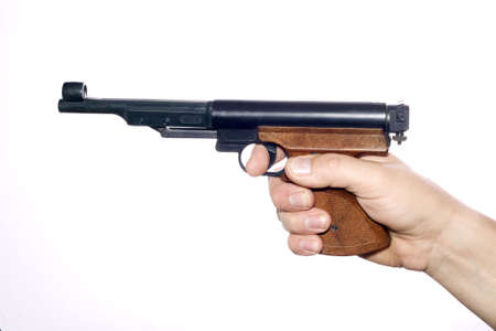 Pneumatic pistol in hand over white photo