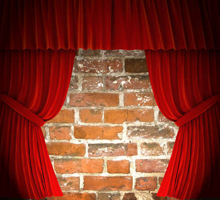 Red curtains over brick wall.  photo