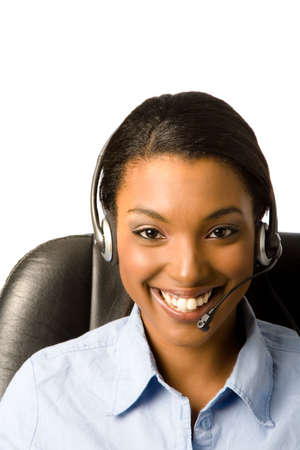 Close-up of a happy, friendly young african american woman wearing a headset Stock Photo - 910343