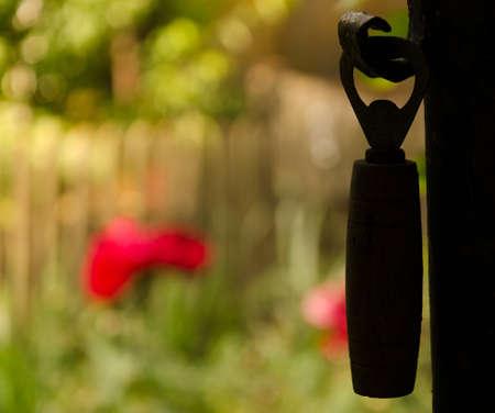 bottle opener: Silhouette of a hanging bottle opener