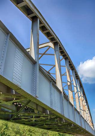 triplet: Old rusty railway bridge in Hungary