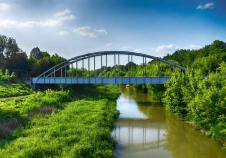 triplet: Old rusty railway bridge over the river in Hungary