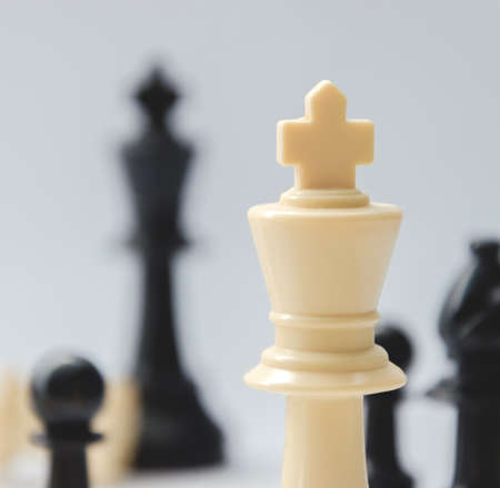 battle cross: the king - plastic chess pieces, white background
