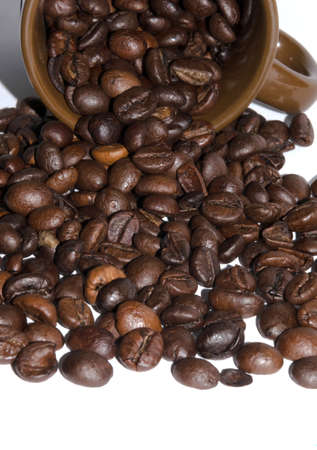 scattered on white background: coffee beans scattered on white background, brown coffee cup