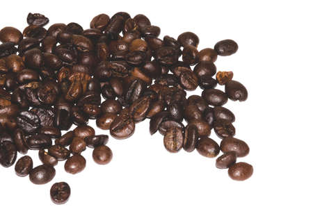 scattered on white background: coffee beans scattered on white background