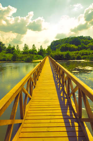 connective: summer landscape - wooden bridge over the lake Stock Photo