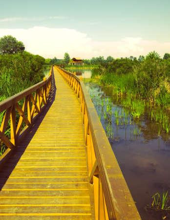 stilt house: Wooden bridge and stilt house at the lake