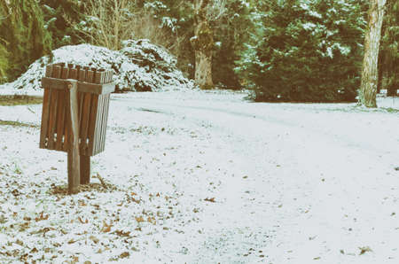 dustbin: Wooden dustbin along the snow covered footpath in the forest at winter
