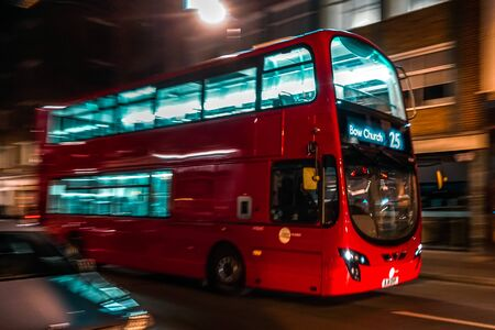 A red London bus in motion. Panning technique was used to take this image. Concept of rush hour and in hurry