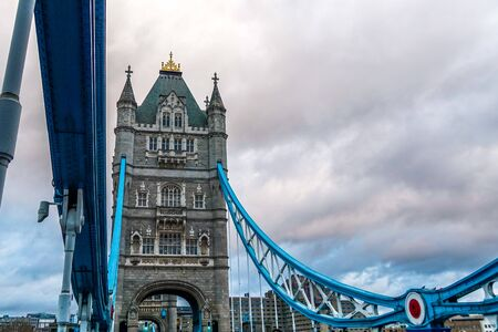 Tower Bridge in London city, United Kingdom with thick clouds on the background.